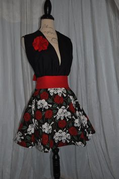 I like the roses and skulls but it might be a little much for my style, maybe if just the ribbon around the waist was skulls n roses.