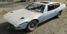 This 1971 Lamborghini Espada was wrecked in the late 1980s and acquired by the seller as a project; the car is said to be complete apart from some window glass. 17k miles are claimed on the V-12, and though not-running, the seller says the engine isn't seized. Damage to the car appears to be li