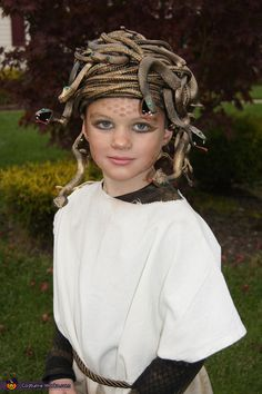 Rubber snakes + gold hairspray = quick and easy Medusa costume. Use fishnet stockings and eyeshadow to make the scales on forehead.