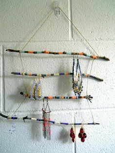 Painted twig jewelry holder - silver rods & chains would be super cool.