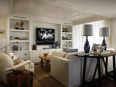 Suzie: Cindy Ray Interiors - Fantastic living room with tray ceiling, groove wall, white ...