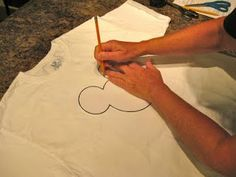 Step by step instructions for making Mickey tie-dye shirts.  We do these every year!
