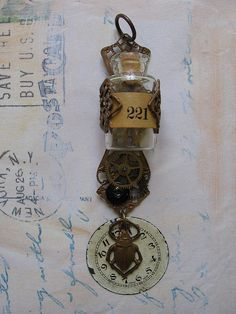 Good idea--the filigree wrapped around the bottle; Steampunk Jewellery by Amanda Scrivener, via Flickr