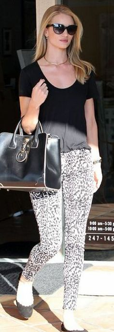 Who made  Rosie Huntington-Whiteley's black leather handbag, sunglasses, leopard jeans, and scallop suede ballet flat shoes?