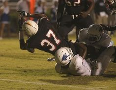 Wade Hampton's Shaheem Stupart stretches to score a TD against Woodmont's Jawanza Adams.