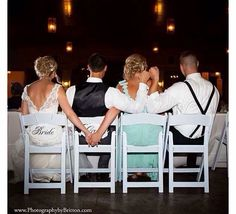 Bride, groom, maid of honor and beat man photograph.