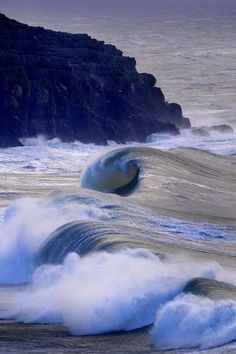 Seascape -  Rolling waves at Hells Mouth (Porth Neigwl) North Wales. - photo by John Wormald
