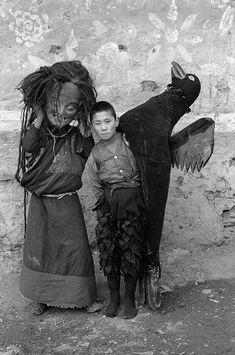 Little Bird Boy & Mommy....in Some Third World Country....Now This is a Scarey Halloween Photo!