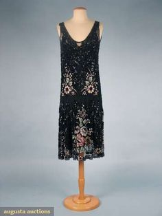 "Stunning c1925 party dress, Black cotton net covered in black sequins & beads in geometric patterns, areas of white w/ pastel color floral beading, label ""Bab La Robe de Jeunesse Handmade in Paris"