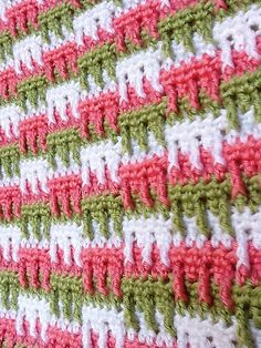 Ravelry: Bright Textures Blanket pattern by Bernat Design Studio. I've done 2 afghans with this Bernat pattern (one as a scrap afghan, the other to match a decor) and both turned out beautifully. I would highly recommend this pattern.