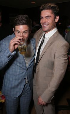 Adam DeVine & Zac Efron from Movie Premieres: Red Carpets and Parties!  The Mike and Dave Need Wedding Dates co-stars share a laugh at the film's after party.