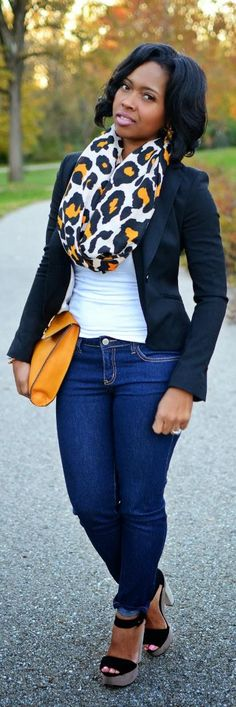 Jeans, white tank top, black blazer, leopard scarf, mustard hand bag and black wedges.