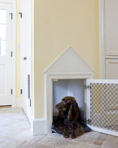 A built-in dog crate. - cut drywall the size you need for your pet - line inside space with drywall, paint. Frame outside with molding and add 2 strips of decorative molding to form triangular pediment, paint molding & inside pediment area. attach framed grill with hinges.