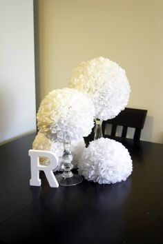 DIY Tissue Pomander centerpiece - made these for our reception! (didnt make them all alone) What if we did something like this as center pieces, except with the cans like I was talking about?