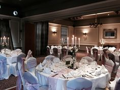 Dusky pink and lace sash with candelabra at The Manor Hotel Yeovil