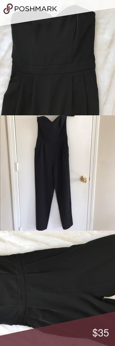 Sleek Black Jumpsuit never been worn, pockets on either side. zips up side H&M Dresses