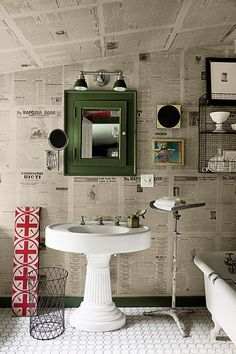 Newspaper wallpaper bathroom with victorian feel. Love the pedestal sink and medicine cabinet. Jornal Wallpaper, Bathroom Decor Pictures, Bathroom Ideas, Funky Bathroom, Guys Bathroom, Office Bathroom, Office Walls, Bathroom Styling, Bathroom Designs