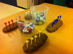 Fine motor activity- balancing marbles on golf tees! Children loved it!