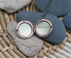 """The kindred locket is my take on the """"best friends"""" necklaces from my middle school years. I always wanted one of those, but I never wanted to choose just on """"best friend."""" Now I don't have to. :: kindred . a whispered hand stamped soul mantra locket"""