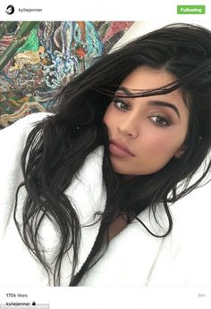 Pucker up: Kylie did her signature pose in a selfie posted on her Instagram on Thursday as she plugged the Candy K lip kit that was released on Friday
