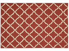 """This 8' x 10'6"""" Portico outdoor rug features a classic latticework pattern that offers purity of design and traditional sophistication in an elegant broadloom. The open work grid in a neutral tone accentuates the richly pigmented colors of this attractive and versatile collection. The densely tufted pile has UV protection that locks in the color, making it an ideal choice for easy living and lasting beauty. This spirited red and cream latticework pattern will assuredly add an exciting dash…"""