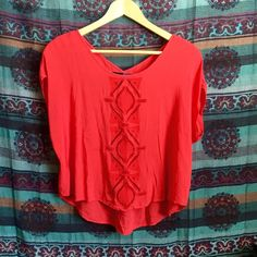 "Coral top 100% rayon material, crochet design in middle of shirt. I am 5"" and it is a shirt on me but could be worn as a crop top for taller wearers. Tag says S but fits like XS. Tops Blouses"