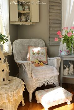 Shabby Cottage Wicker Chair...love the window shutters and corner wall cupboard.