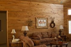 The Rustic Retreat Collection of tongue and groove paneling has wood filled with heart streaks, burled inclusions, and warm brazen knots.