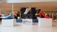 giant origami shoes at New Jersey gardens mall designed by Taro