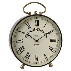 A lovely addition to your work desk or entryway console, this metal table clock showcases a Roman numeral dial for classic appeal.   Pro...