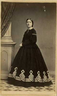 1860's  R B2-F3 Unidentified Woman 3, carte de visite. Woman in dark dress with elaborate diamond pattern band along base of skirt. Two small areas of cupping at top of image.
