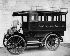 Here another hard working Auto Wagon is seen, this one a circa 1912 model with a fully enclosed body, though the driver sits outside with only a half top to shelter him. This particular truck was owned by the Bond Hill Auto Service Company.