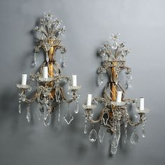 A Pair of Mid-20th Century Cut Glass and Gilt Metal Wall Lights. French. Circa 1940