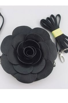 The round purse crafted in PU, featuring elegant flower pattern, round shape with zip around fastening, a short grab strap with stud detail and a long detachable shoulder strap.$24