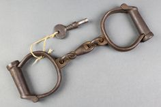 Lot 221, A pair of iron handcuffs marked Hiatt Best Warranted Rought 30 complete with keys, est £50-100