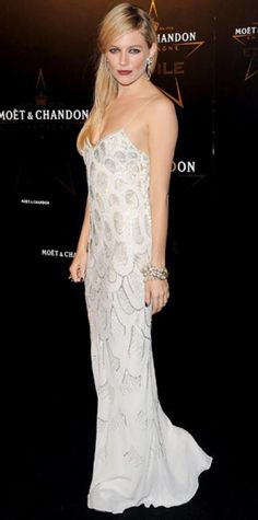 Look of the Day › September 20, 2011 WHAT SHE WORE The British actress walked the black carpet at London's Moet and Chandon Etoile Award event in a beaded Christian Dior gown. WHY WE LOVE IT The girl knows how to accessorize! Sienna Miller embraced the vintage style of her slinky column with eclectic statement pieces including teardrop earrings and a cluster pearl bracelet.