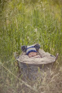 ok now i want this background and bucket but the baby needs to be wrapped in a camo blanket with a little john deere cap on ;)