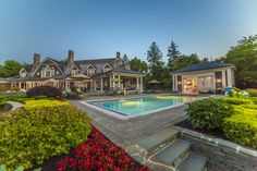 Traditional Swimming Pool with exterior tile floors, Pathway, Pool with hot tub, Raised beds, exterior stone floors