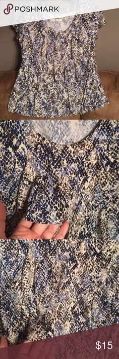 Van Heusen dress blouse This gorgeous blouse. Am be dressed up or down. It has a triple layer look in the front, short sleeves and a scoop neck. In EXCELLENT used condition. Van Heusen Tops