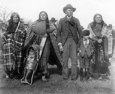 Quanah Parker with three wives, a son and a baby - Comanche - 1905