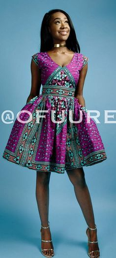 the purple ABBY dress. V neck African print mini dress with fully lined with 2 side pockets and back zip. Made with 100% cotton high quality African print wax fabric.  Ankara   Dutch wax   Kente   Kitenge   Dashiki   African print bomber jacket   African