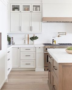 Feelin' all the warm neutrals right now...we especially love how this kitchen can transition from summer, to fall, to winter, to spring… White Kitchen Cabinets, Kitchen Cabinet Design, Diy Kitchen, Kitchen Decor, Glass Cabinets, Awesome Kitchen, Kitchen Island, Kitchen Ideas, Natural Wood Kitchen Cabinets
