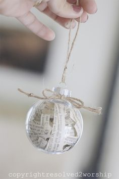 Christmas ornament made from old book pages and clear ball...now I know what to do with all those fortunes I can't seem to throw out!