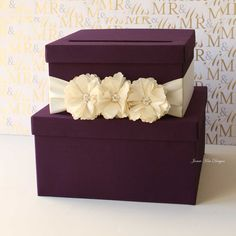 They say that purple is the color of royalty, and this deep purple tiered wedding box ($102) will surely make you feel like a princess on your big day.