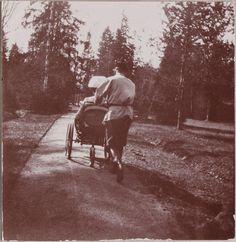 Tsar Nicholas ll of Russia wheeling his wife around in her walking wheelchair. Familia Romanov, Alexandra Feodorovna, Empire, Tsar Nicholas, The Lost World, Her Majesty The Queen, Imperial Russia, Family Album, European History