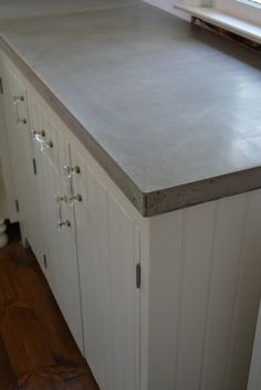 Oyster shells were added to the cement for a sparkle to the concrete countertops..I love this idea..