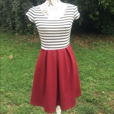 Super cute striped dress with red skirt Super cute striped dress with red skirt. Size small, length 32 inches. All purchases are shipped next day. Buy two get one free. Dresses