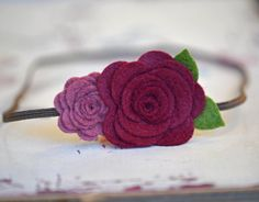 One gorgeous petite rolled roses and one larger rose grace this headband making it elegant, simple and sweet.    The rosettes are made with a luxurious