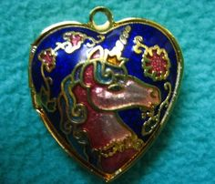 Beautiful, elegant, one of a kind vintage and hand painted cloisonne heart pendant lock that is double sided and puffy. One side features a light red enamel unicorn and the other side features a butterfly.