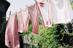 Hanging clothes on the line. Both my parents would do this. Mostly my mom, though. Dad would help out on the weekends.